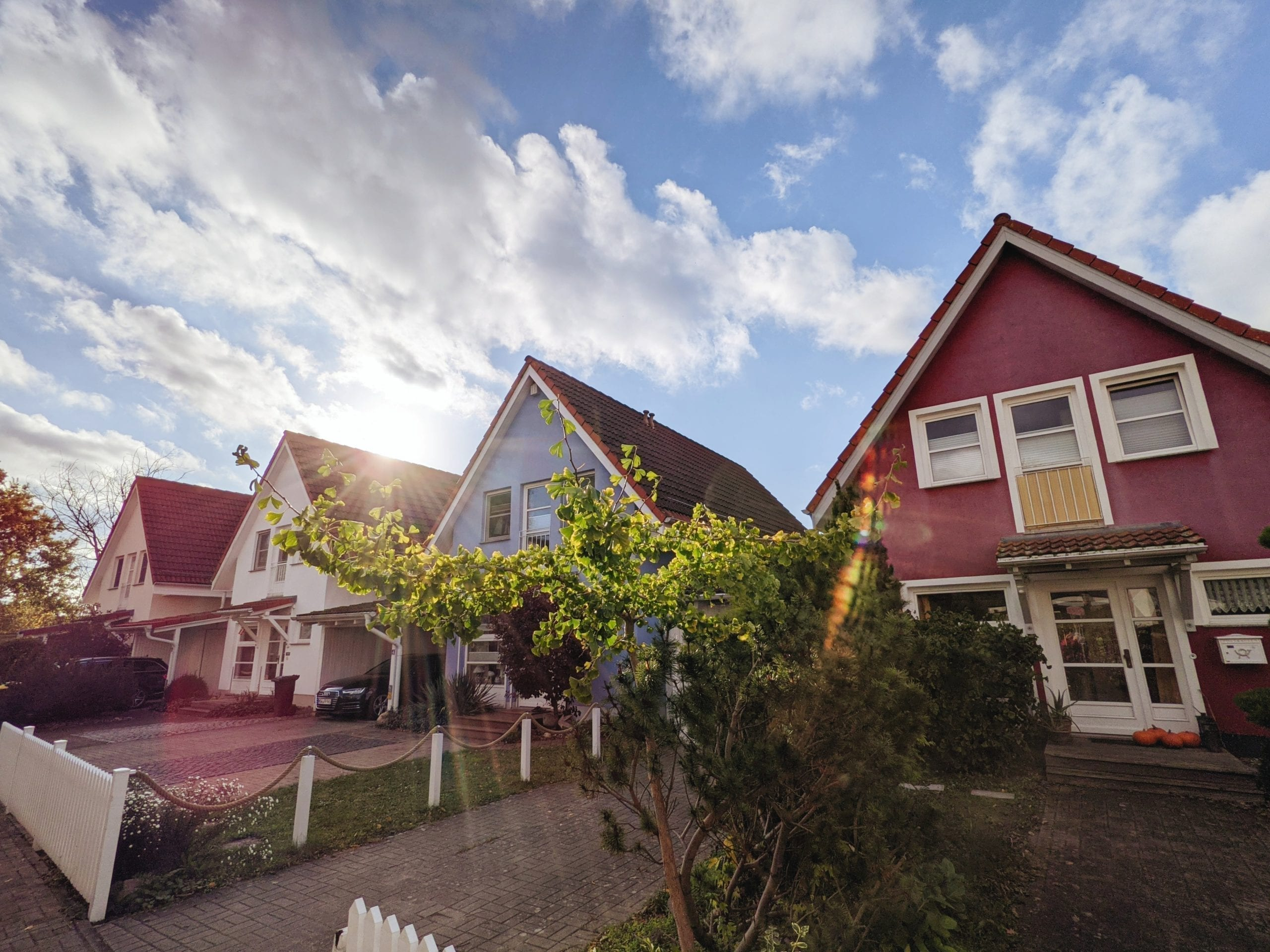 A-frame style houses in a row with sunshine peeking from behind one roof; highlighting mortgage renewals