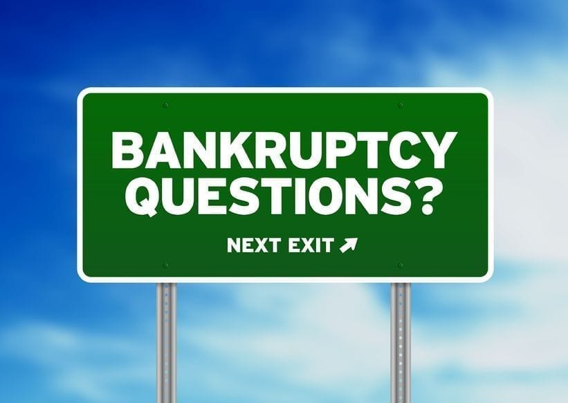 Road sign illustration that says 'bankruptcy questions? next exit' with an arrow pointing right; highlighting getting a mortgage while having a previous bankruptcy