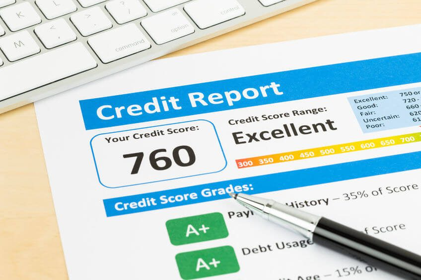 A credit report document with a high credit score, sitting on a desk with a pen and keyboard