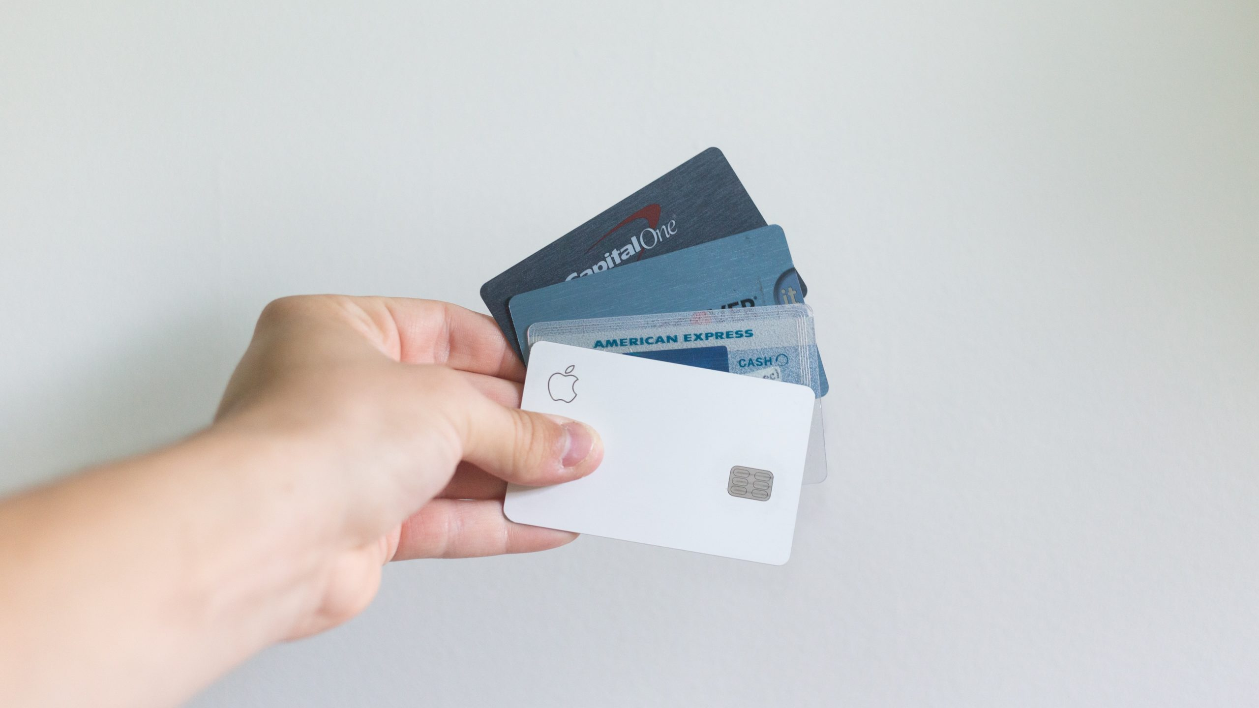 hand holding panned credit cards, highlighting means of acquiring credit for a mortgage