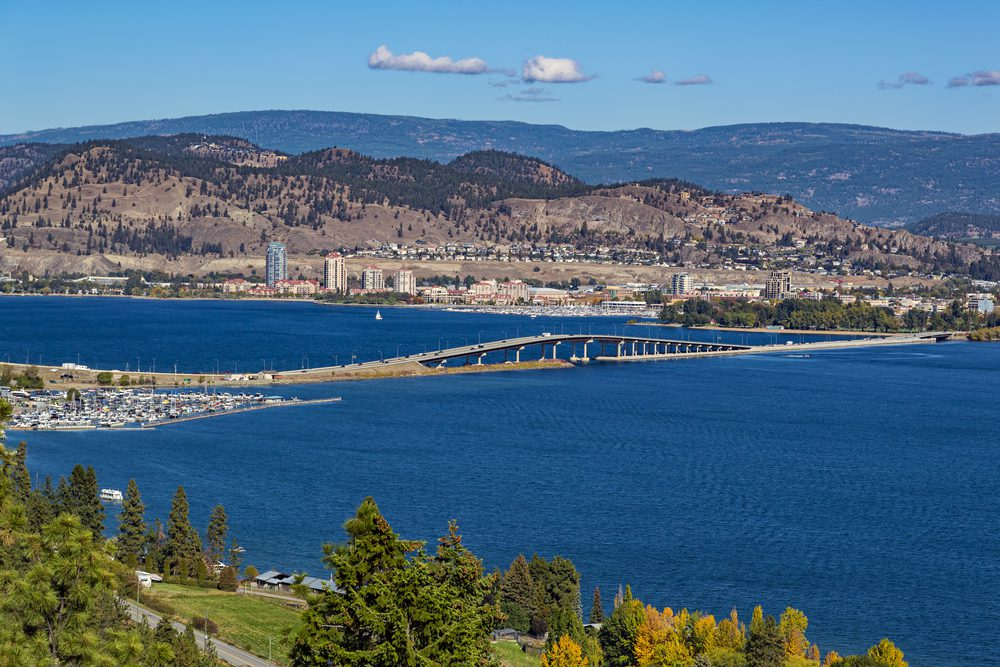 The City of Kelowna view from West Kelowna with the bridge over the lake, highlighting where Mortgage Okanagan is located
