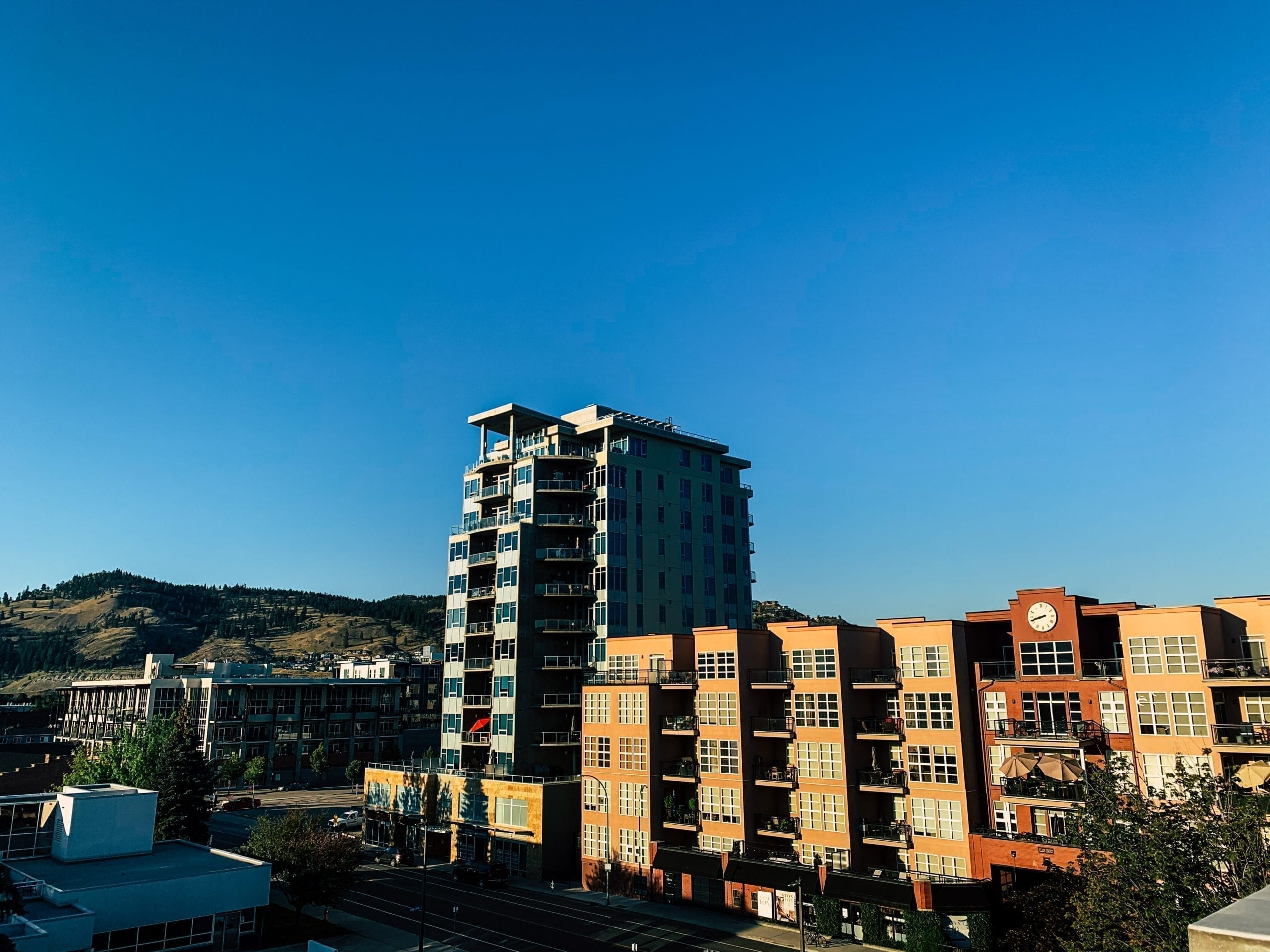 Downtown Kelowna on a clear blue day, highlighting buying a second property while renting out the first