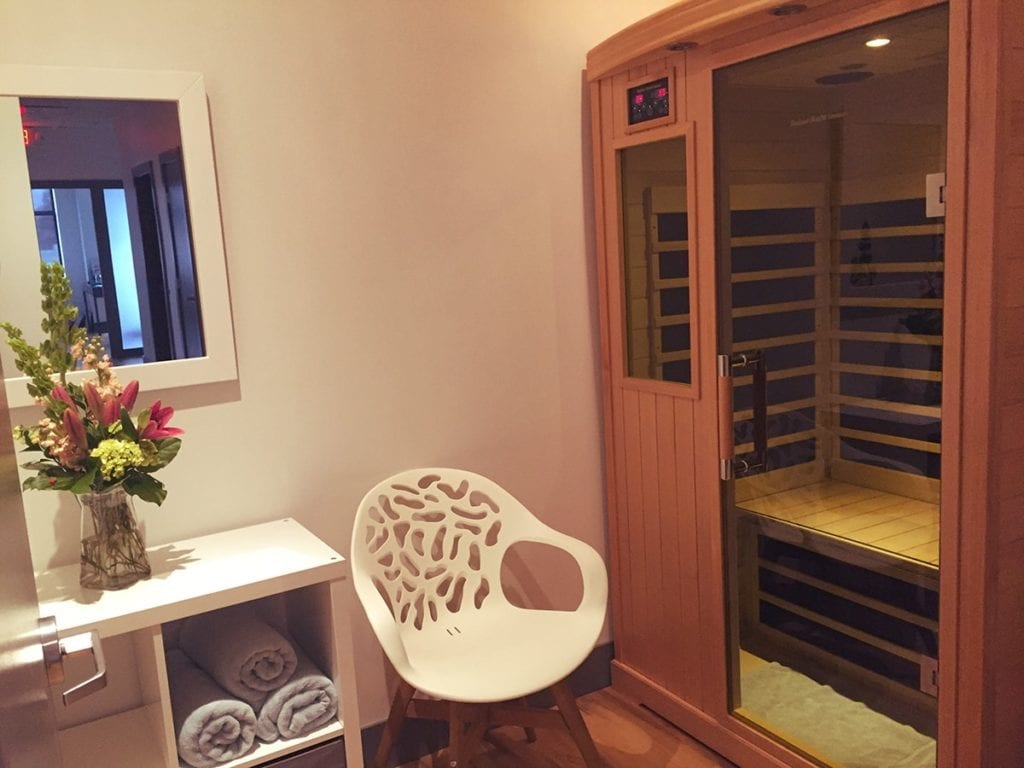 Mind Body Soul Sauna with chair and towels folded