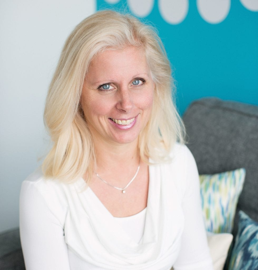 Dr. Anita Bratt headshot blonde woman with white blouse; learn more about our team here