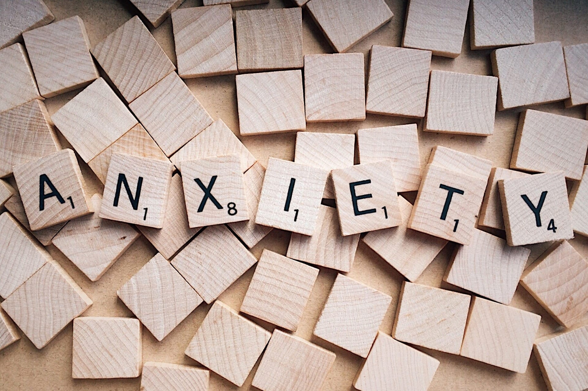 Scrabble pieces spelling out the word anxiety, highlighting the topic of this piece, managing anxiety