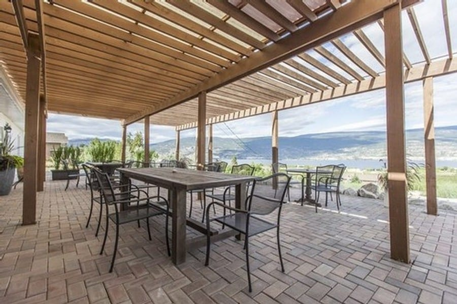 patio with table and chairs overlooking okanagan lake from Lunessence, one of our favourite Summerland wineries