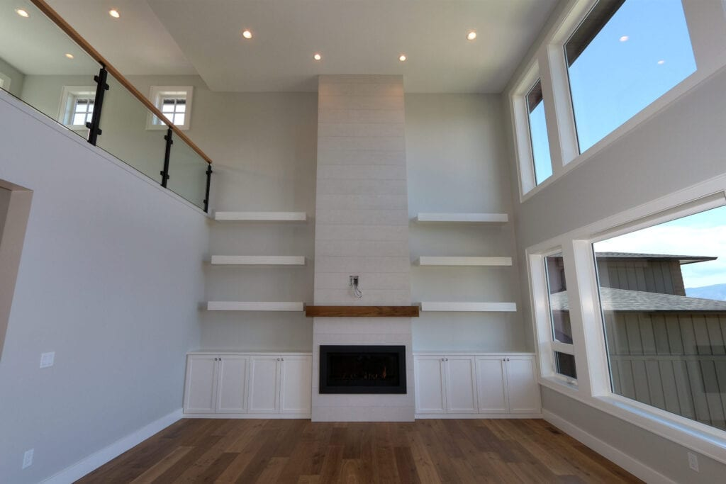 Custom built fireplace and entertainment unit at 462 Rockview Lane