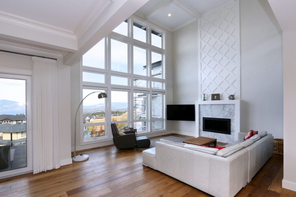 Beautiful custom fireplace with big windows and bright spacious interior design of 470 Rockview Lane