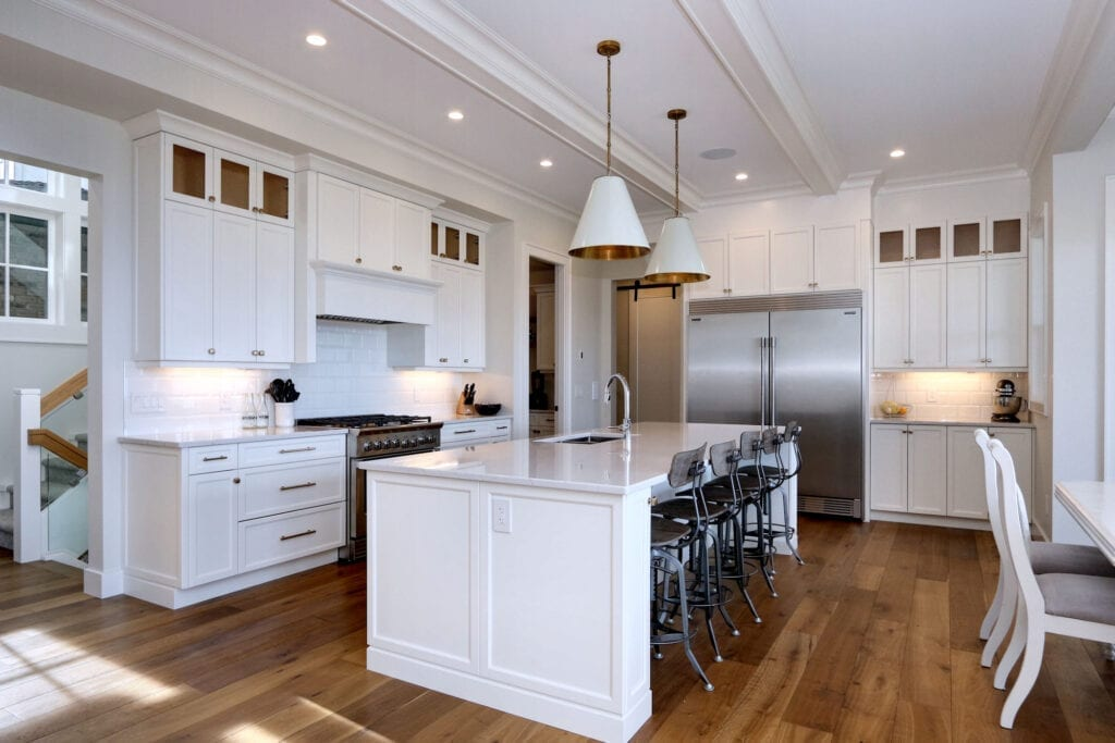 Open concept kitchen with large white island at 470 Rockview Lane, a custom home build and interior design by Stark Homes