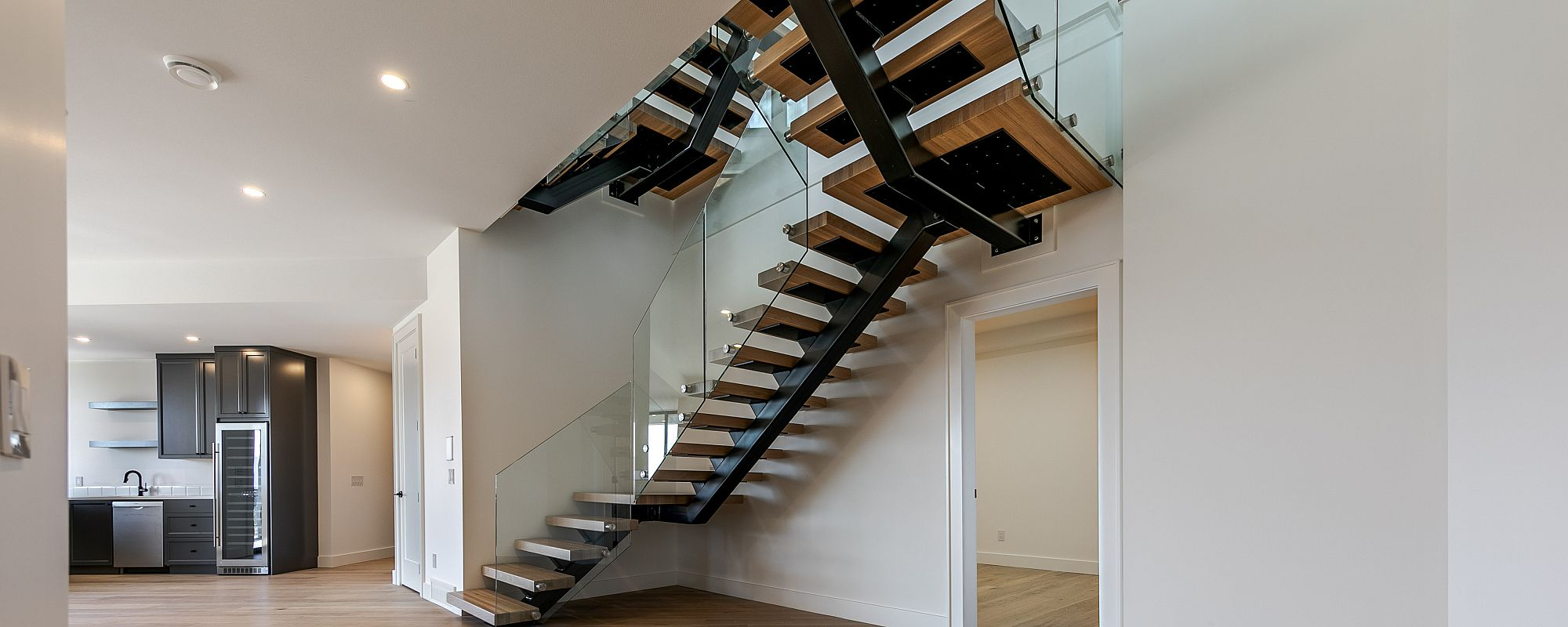 Feature staircase with wooden steps and black beams