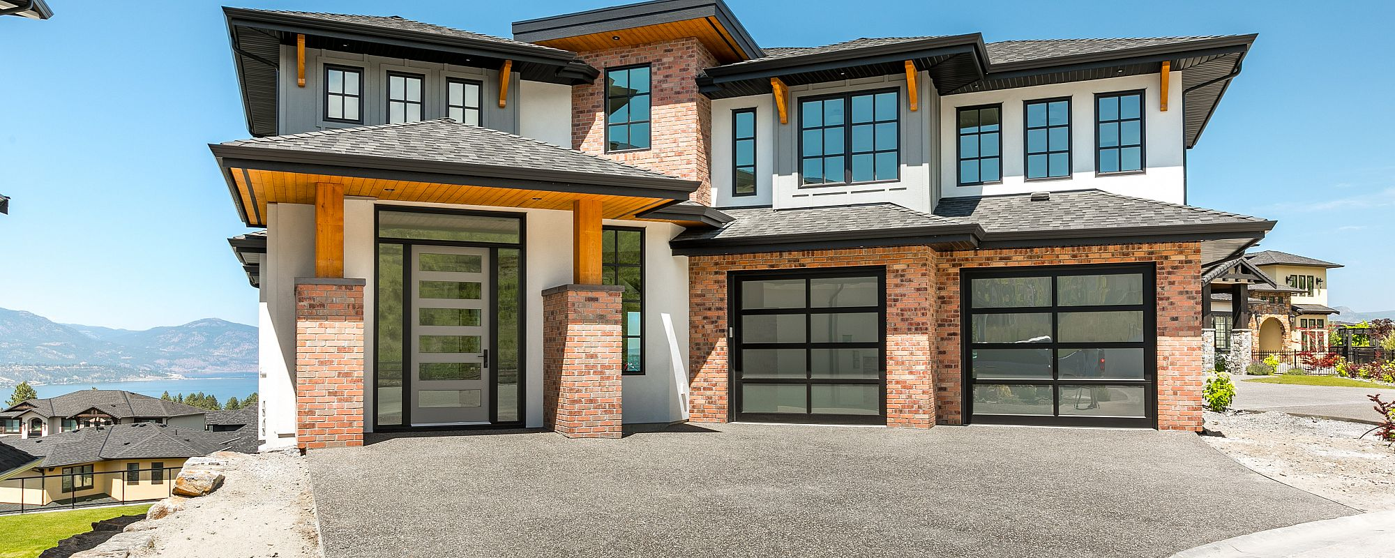 Stark Homes front view of custom home build with black frame and glass panelling
