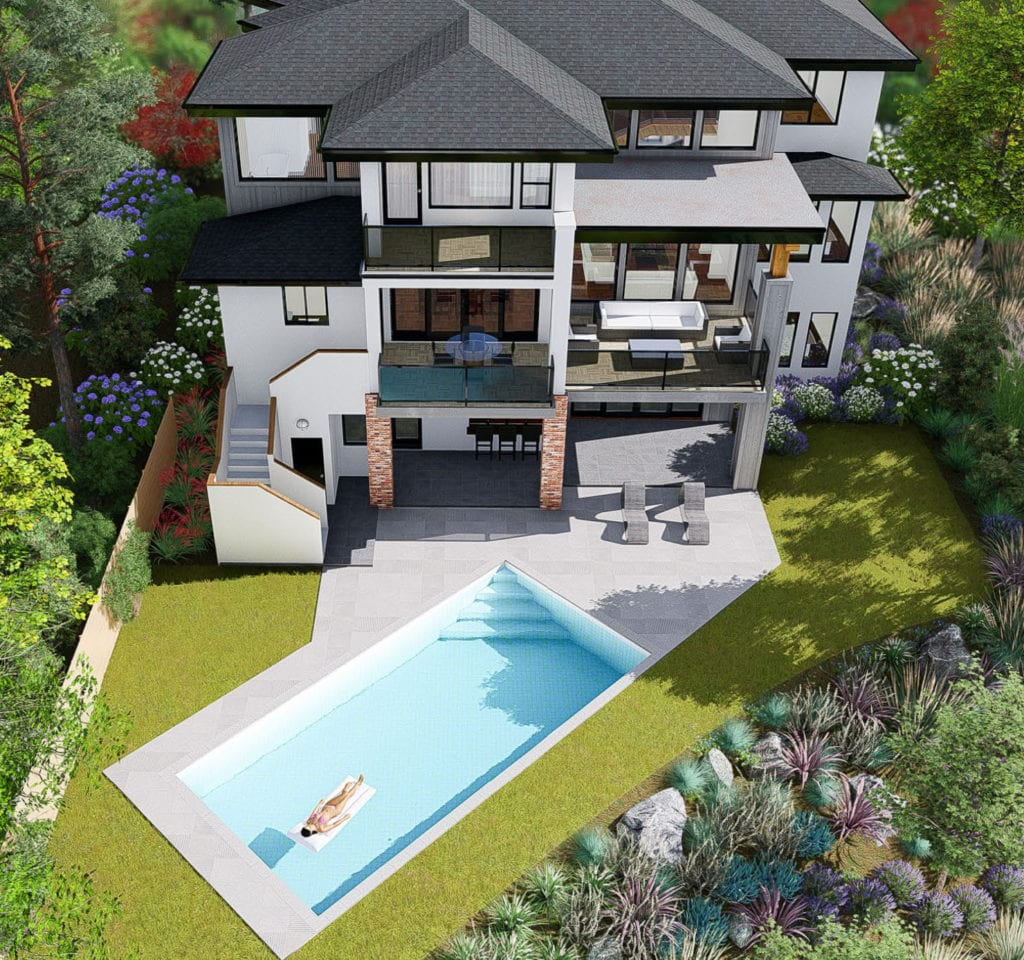 Aerial photo taken in the summer of custom built Okanagan home with a pool in the yard.