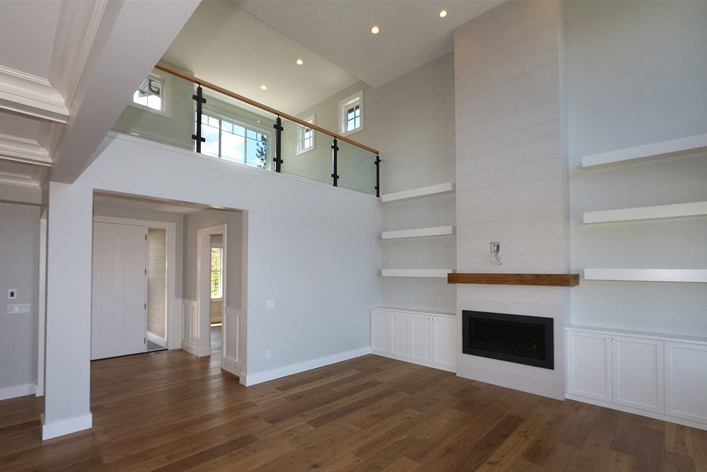 462 Rockview Lane open concept living area built by Stark Homes, featuring a white floor to ceiling fireplace with entertainment setup