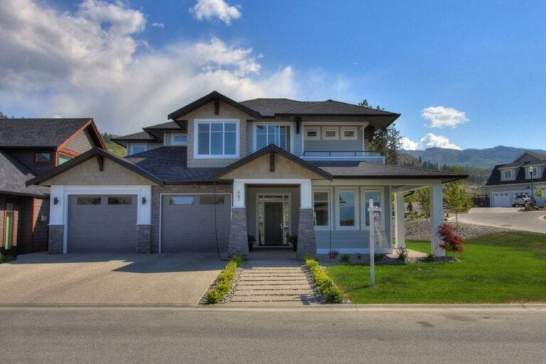 Custom home front entryway for 447 Lakepoint Drive in Kelowna with stone work at double garage