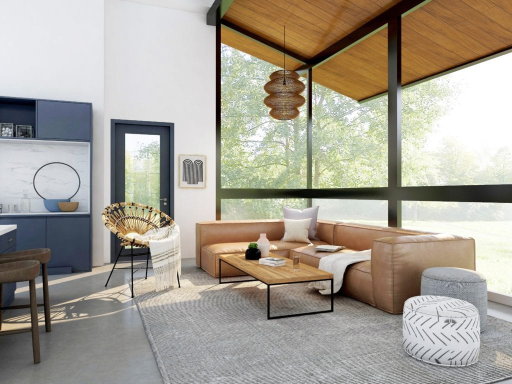Contemporary home design style living room with brown leather sofa, black framed floor to ceiling windows and a light grey rug.