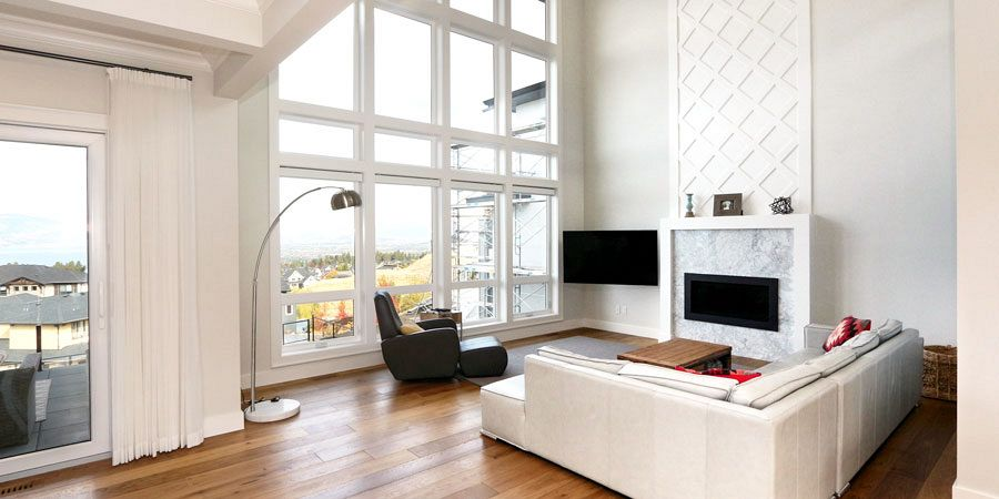 Stark Homes living room interior design and build with custom marble and white lattice fireplace in open concept