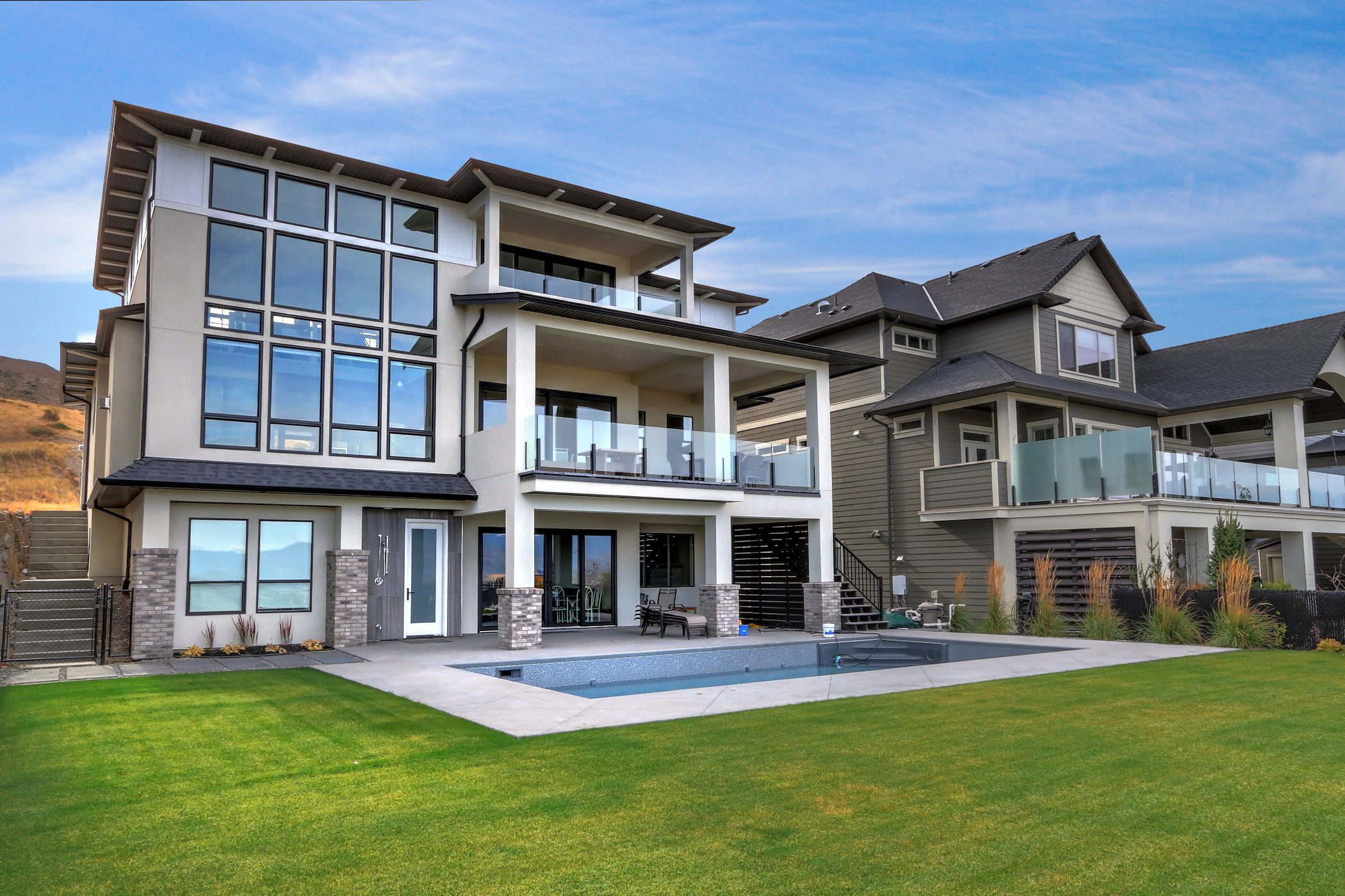 Stark Homes Custom Home exterior view showing multiple decks and an in-ground pool nd new build home warranty