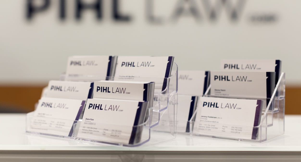 Pihl Law Business Cards in stand on desk