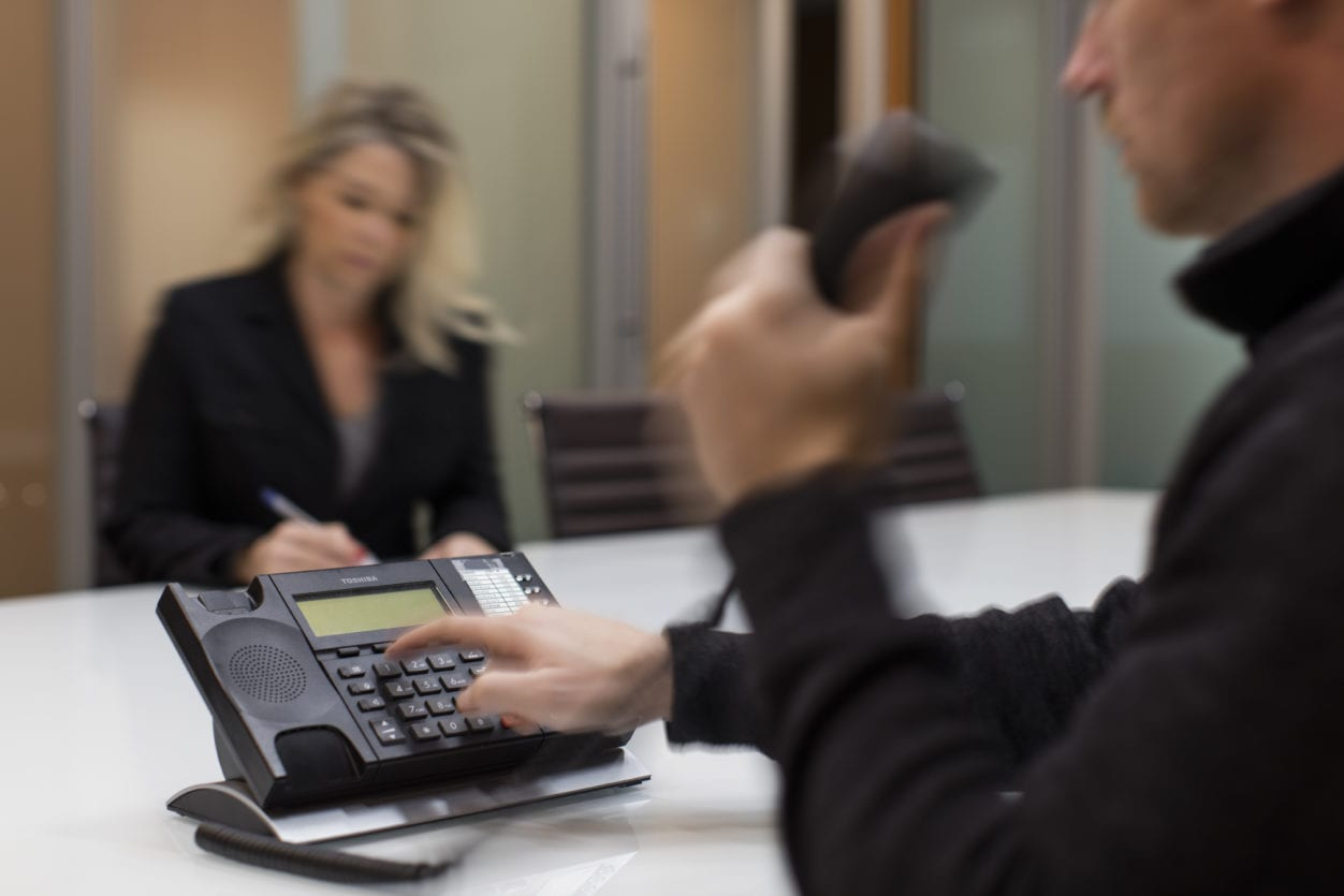 Man Dialing Phone highlighting working with a lawyer