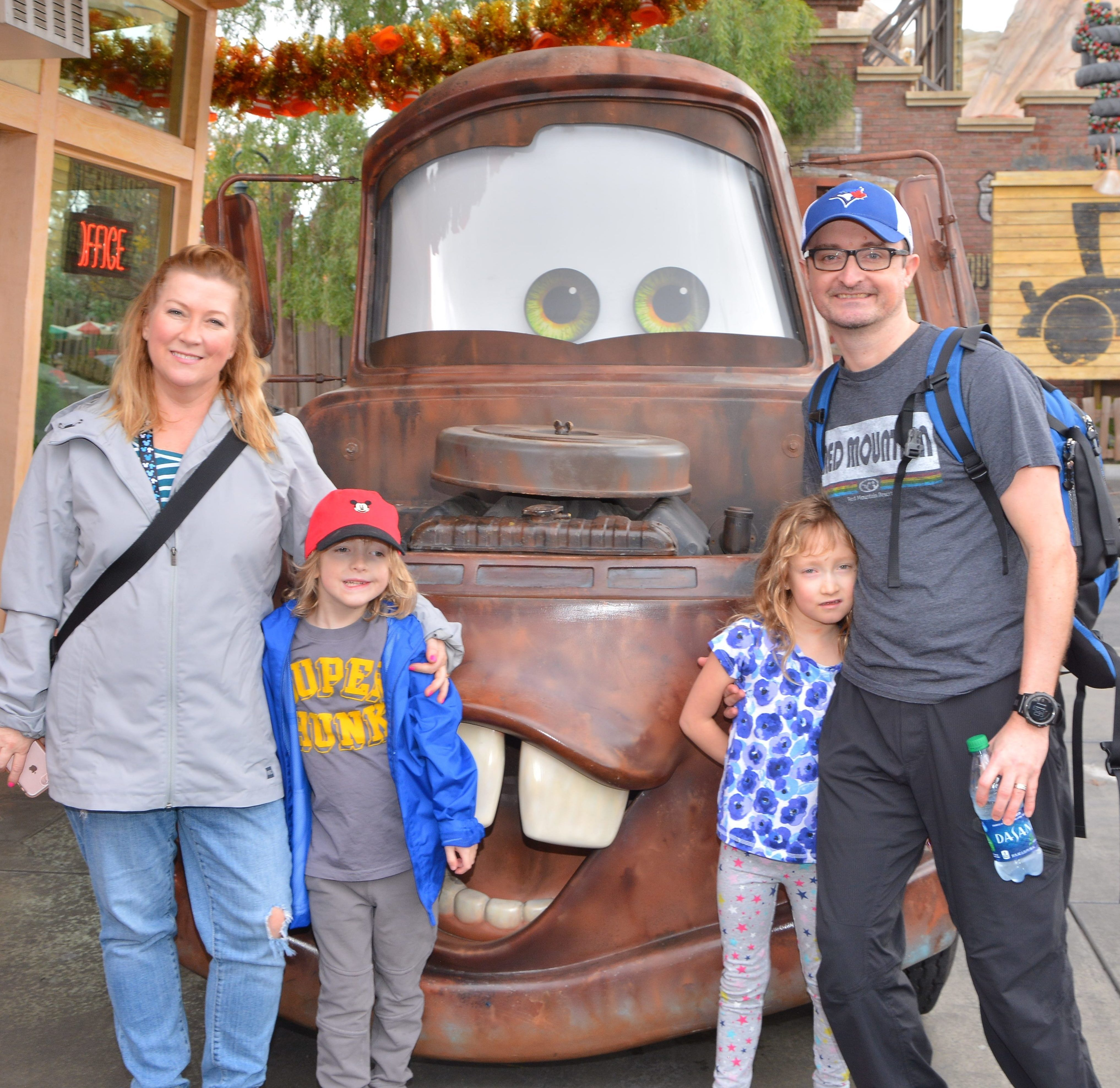Andrew and Lesley with two children and Cars Movie Tractor