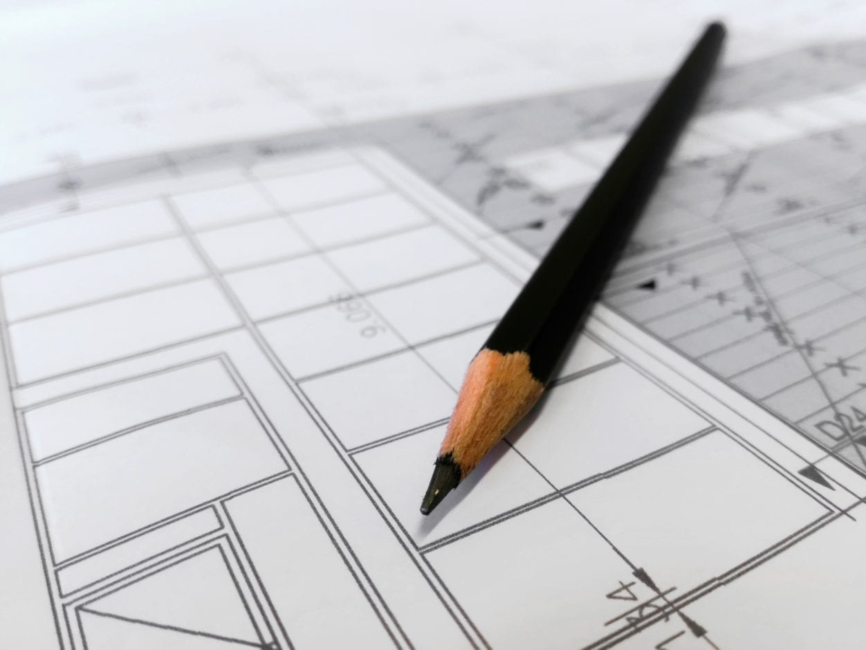 Closeup of a pencil on a construction drawing highlighting builder's lien