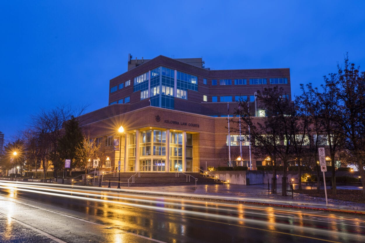 Dusk after rain and the lights shining on the kelowna courts house during COVID-19 pandemic