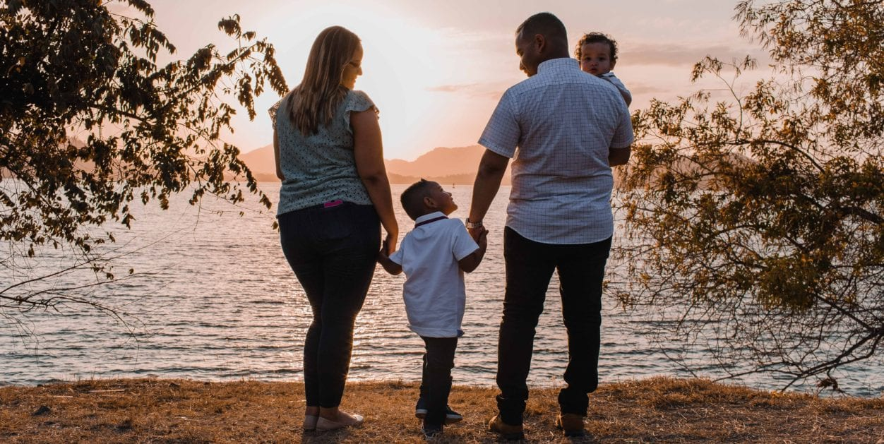 Family with two children standing at the beach highlighting Make a Will Week at Pihl Law