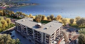 Birds eye view of one of Kelowna's new flexible-stay hotels, The Shore Kelowna, with Okanagan lake in the background