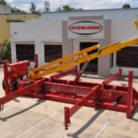Schramm Loadsafe trailer mounted automated pipe & casing handling system in parking lot outside of Schramm' s Australia location.