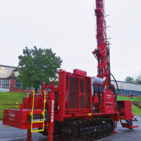 Schramm T450GT compact maneuverable drill rig with GEOCASE casing rotator system.