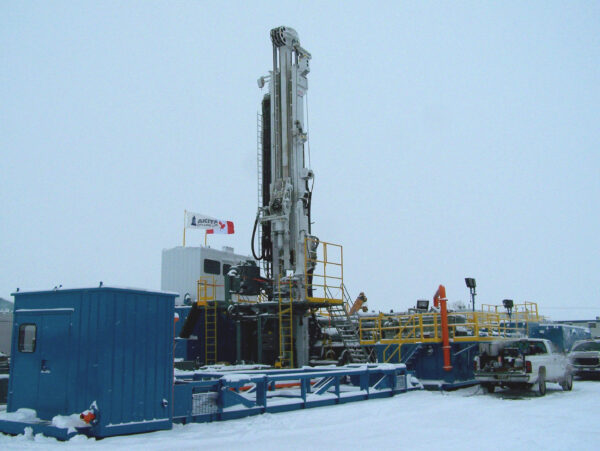 Schramm Telemast TXD Drill Rig surrounded by snow.