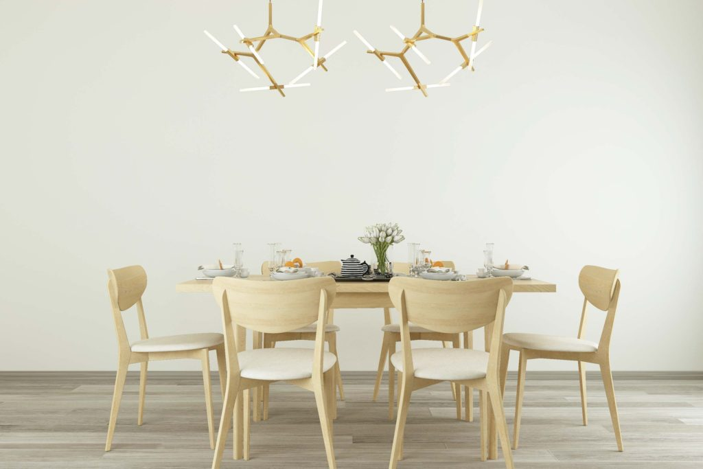 Light and bright dinning room with trendy light fixture